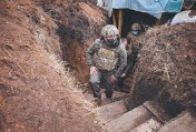 ?? Frontline AFP near ?? Volodymyr Zelensky visits the Zolote, Lugansk, on Thursday troops at the