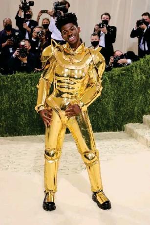 ?? (Getty) ?? The rapper wore custom Ate l ier Versace