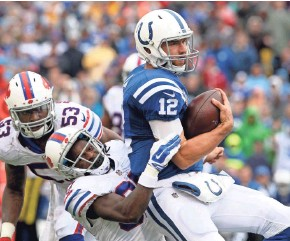 ?? TIMOTHY T. LUDWIG, USA TODAY SPORTS ?? Nickell Robey and the Bills made life tough for Colts quarterback Andrew Luck.