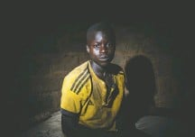 """?? SALWAN GEORGES/THE WASHINGTON POST ?? Karim Bakary, 16, came from Burkina Faso to work on cocoa farms in Ivory Coast. """"We suffer a lot to get some money there,"""" he said. """"We came here to be able to have some money to eat."""""""