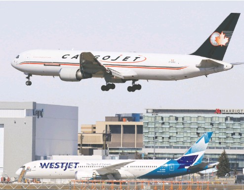 ?? GAVIN YOUNG / POSTMEDIA NEWS FILES ?? Cargo shipping has hit peak levels as many retail storefronts remain closed during COVID-19 lockdowns, and Canadian company Cargojet's shares gained 108 per cent in 2020.