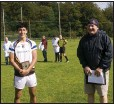 ??  ?? Adam Arslan is presented with the Wicklow People sponsored man of the match award by Liam O'Loughlin.