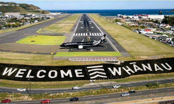 ?? Photograph: Wellington international airport/ Getty Images ?? A welcome sign at Wellington airport. There is no indication that the coronavirus infection in an Auckland airport worker will affect the travel bubble between Australia and New Zealand.