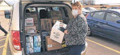 ?? CONTRIBUTED ?? Betty Begg, the founder and chief executive officer of Gifts from the Heart, masks up when heading to pick up supplies for low-income families and others who may need help. She recently received the 2020 Forbes Kennedy Volunteer of the Year Award.