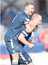 ??  ?? Martin Woods and Liam Boyce celebrate.