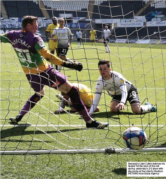 ?? PICTURE: Huw Evans Agency ?? Swansea's Liam Cullen watches his header hit the back of the net during yesterday's 2-2 draw with Wycombe at the Liberty Stadium