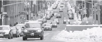 ?? WAYNE CUDDINGTON/OT­TAWA CIT­I­ZEN ?? One-way Met­calfe Street (seen here) and O'Connor Street are can­di­dates for two-way con­ver­sion.