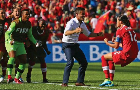 """?? MADDIE MEYER/GETTY IMAGES FILE PHOTO ?? Coach John Herdman, centre, and captain Christine Sinclair celebrate a Sinclair goal during the 2015 Women's World Cup. Sinclair's tweet on Monday that she was """"speechless"""" about Herdman taking over the moribund men's national team summed up the..."""