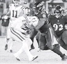 ?? KARL MERTON FERRON/BALTIMORE SUN ?? Justin Houston (50) sacks Colts quarterback Carson Wentz on Monday in the fourth quarter in Baltimore.
