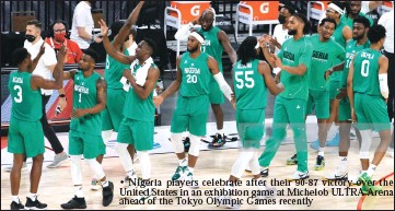 ??  ?? • Nigeria players celebrate after their 90-87 victory over the United States in an exhibition game at Michelob ULTRA Arena ahead of the Tokyo Olympic Games recently
