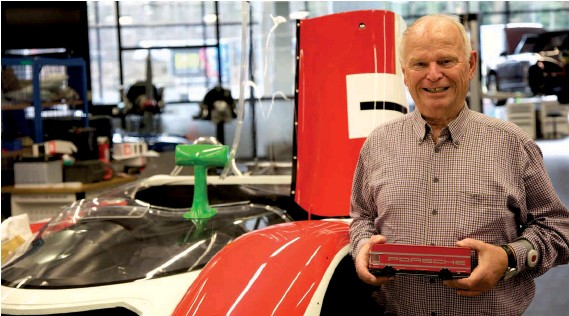 ??  ?? Above: Werner Hillburger clutches a model of the Mercedes LO317 he drove to circuits across Europe transporting cars for Porsche