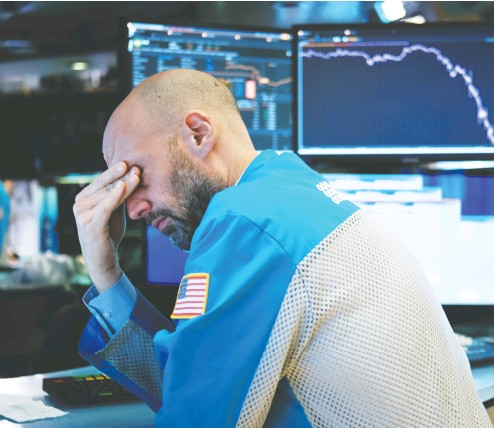 """?? Spencer Platt / Getty Images files ?? Useless phrases like""""the stock market hates uncertainty"""" get on the nerves of people who work in the industry."""