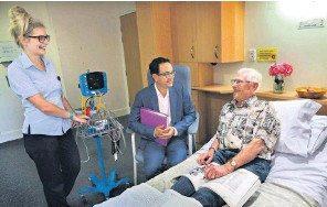 ?? Picture: Nic Ellis ?? Nurse Lucy McHardy, Dr Stephen Rodrigues and patient Tony Lange at Hollywood Private Hospital.