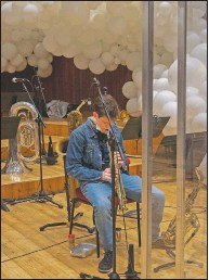 ??  ?? A jazz orchestra musician plays his saxophone before rehearsal at the Giuseppe Verdi Music Conservatory.