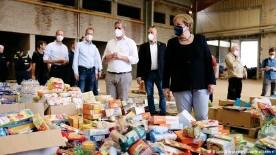 ??  ?? Angela Merkel visits a food distribution warehouse in Bad Münstereifel