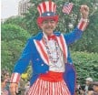 """??  ?? """"The world's tallest Uncle Sam"""" led children in a parade at the Chicago History Museum."""