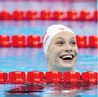 ?? THE ASSOCIATED PRESS/FILES ?? Penny Oleksiak, here after winning gold and setting a new Olympic record in the women's 100-metre freestyle in Rio, is now armed with wearable technology designed to help her swim even faster.