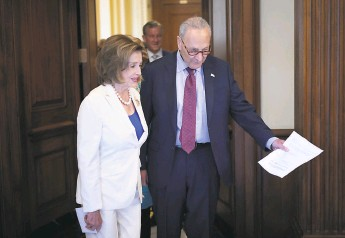 ?? Win McNamee / Getty Images ?? Rep. Nancy Pelosi (left), DS.F., is escorted to a news conference by Sen. Chuck Schumer, DN.Y. Schumer's deadline for the infrastructure bill is in doubt.