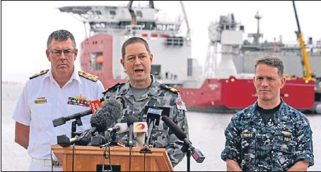 ??  ?? Above: US navy captain Mark Matthews, right, Royal Australian Navy commodore Peter Leavy, commander of join task force 658, centre, and chief of the navy Vice-Admiral Ray Griggs at a press conference at naval base HMAS Stirling. Below: a towed pinger...