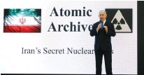 ?? Cohen/Reuters) (Amir ?? THEN-PRIME MINISTER Benjamin Netanyahu unveils Iran's 'secret nuclear archives' during a press conference in Tel Aviv in 2018.