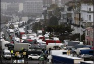 ?? FRANK AUGSTEIN — THE ASSOCIATED PRESS ?? Vehicles wait at the entrance to the Port of Dover, that is blocked by police, as they queue to be allowed to leave, in Dover, England, on Wednesday.