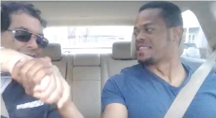 ??  ?? A frame grab shows Calgary Mayor Naheed Nenshi, left, in a hired driver car during a ride recently in Boston. Nenshi voiced his thoughts on the recent Uber application in Calgary while the trip was being broadcast through a live-streaming app.