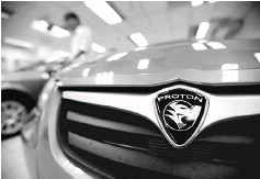 ?? — Reuters photo ?? The Proton-Geely tie-up promises to upend Proton from its slowing sales, to ramping up production to 500,000 cars over the next three years, which is more than five times its current production.