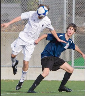 ??  ?? Glenlyon Norfolk's Mika Gerhking heads the ball in front of Claremont's Sam Prett in Colonist Cup semifinal senior boy's soccer action at Uvic Tuesday. Glenlyon Norfolk won the game 1-0.