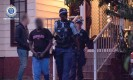 ?? Photograph: NSW police ?? NSW police make arrests in Sydney related to the alleged extortion a senior Iraqi politician.