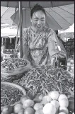??  ?? Center: A vendor sells produce at a food market in the ancient town of Luang Prabang, northern Laos.