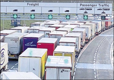 ??  ?? Lorries queue at the Eurotunnel terminal over Christmas