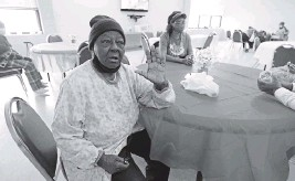 ?? ROGELIO V. SOLIS AP ?? P.M. Browner, left was at first apprehensive about receiving the COVID-19 vaccine, but waits for a transportation bus at the Rev. S.L.A. Jones Activity Center for the Elderly to take her to receive a vaccination on Wednesday, in Clarksdale, Mississippi. The 88-year-old said she thinks vaccinations will eventually be required, and she wants to be able to continue to socialize at a local senior center.