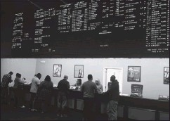 ?? RANDY HALLMAN/TIMES-DISPATCH ?? Gamblers place their sporting-event bets at the Dover (Del.) Downs Casino. During the initial application period for mobile betting in Virginia, 25 companies applied for permits in the commonwealth.