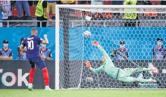 ??  ?? France's Kylian Mbappe has a penalty kick saved by Switzerland goaltender Yann Sommer during the shoot-out to decide a 5-4 shootout win for Switzerland at Euro 2020 in Bucharest, Romania on Monday.REUTERS