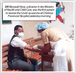??  ?? DR Maxwell Hove, a director in the Ministry of Health and Child Care, was the first person to receive the Covid-19 vaccine at Chinhoyi Provincial Hospital yesterday morning