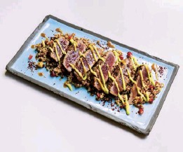 ??  ?? Above Lamb chops marinated in kabsa and plums, charcoalled hispi cabbage, vine leaves and barberries chimichurri.