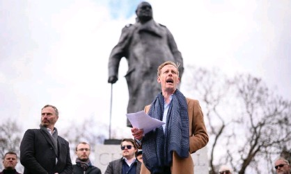 ??  ?? Laurence Fox launches his mayoral manifesto in front of the statue of Churchill in Parliament Square, London. Photograph: Leon Neal/ Getty Images