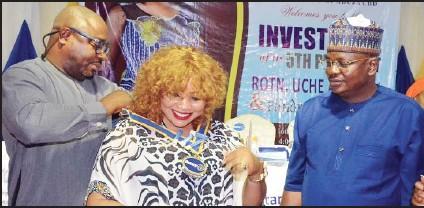 ??  ?? •From left: President, Rotary Club of Abuja, Sapphire, Festus Nwadike; Fifth President, Rotary Club of Abuja, CBD, Mrs. Anne Obi and former President, Daramola Ganiyu during the investiture of Mrs. Obi as the Fifth President of the Club, in Abuja...at the weekend