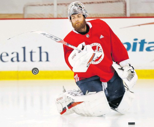 ?? PABLO MARTINEZ MONSIVAIS / THE ASSOCIATED PRESS ?? Washington Capitals goaltender Braden Holtby — at practice in Arlington on Friday — went from beginning the playoffs as the backup to having his name now mentioned in the Conn Smythe Trophy conversation.