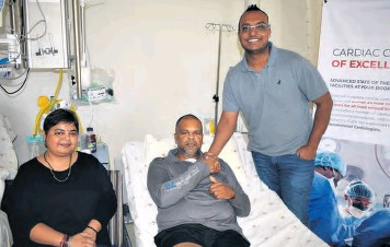 ??  ?? Mrs Joshila Ramkilowan, Mr Yedekar Ramkilowan and specialist cardiothoracic surgeon Dr Sherwin Ramghulam shortly before Mr Ramkilowan was discharged on Monday. Better known in the community as 'Warrant Officer Ram', Mr Ramkilowan expressed his deepest gratitude towards Dr Ramghulam, a well as the Melomed theatre team and supporting staff, for saving his life. The Ramkilowans say they are grateful the cardiothoracic centre of excellence was there when they needed it the most - and with it being located 'right on our doorstep', they did not have to travel far to seek immediate medical intervention