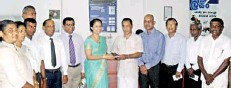 ??  ?? A Laksetha senior citizens account holder receiving the passbook from Lankaputhra Development Bank Chairperson Kumudini Kulatunga in the presence of General Manager and CEO Lasantha Amarasekera, Assistant General Manager Ranjith Disanayake and Chief...