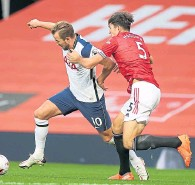 ??  ?? Kane and Maguire tussle earlier this season