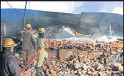 ?? PTI ?? Firefighters at the site. The leather manufacturing factory in Mundka collapsed due to the massive blaze on Thursday.