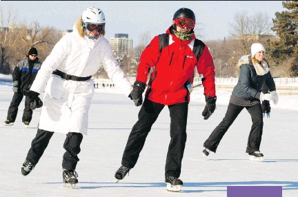 ?? DARREN BROWN/OTTAWA CITIZEN ?? The freezing cold weather doesn't seem to bother Ruth and Walter Skof, who hold hands as they skate along the Rideau Canal Skateway at Fifth Avenue on Friday .