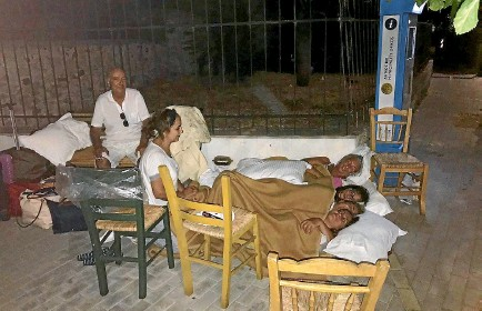 ?? PHOTO: REUTERS ?? People sleep in the street in Kos, Greece, after an earthquake in the Agean Sea between Greece and Turkey.