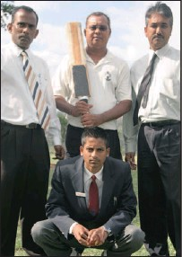 ?? Picture: NQOBILE MBONAMBI ?? Phoenix Secondary principal Siva Subrayen, left, Elvis Govender (DDCU coach) and Phoenix Secondary's cricket master, Raj Maharaj, are the driving force behind, front, Ryan Seerpath's progress in the world of cricket.