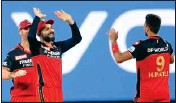 ?? PTI ?? Royal Challengers Bangalore players celebrate during Indian Premier League 2021 match