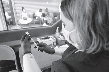 ?? JAMES ESTRIN/THE NEW YORK TIMES ?? A nurse administers COVID-19 vaccines Tuesday from a van in the Bronx borough of New York City. Breakthrough infections — those occurring in vaccinated people — are still relatively uncommon, experts say.