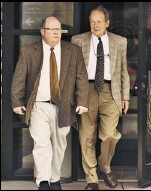 ?? Ricardo Thomas / The Detroit News ?? Chris King, left, and Barry King, brother and father of Timothy, leave a Michigan State Police post in 2009. The King family sued to get records.