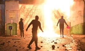 ??  ?? Young people clashed at the Peace Gate at Springfield Road and Lanark Way on 7 April in Belfast. Photograph: Charles McQuillan/Getty Images